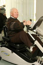 Elderly patient on exercise machine